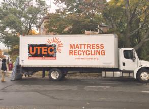 Youth behind mattress truck